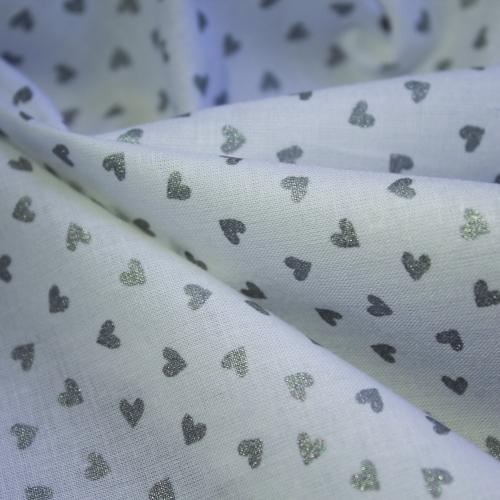 Tissu batiste de coton fond blanc pois argentés