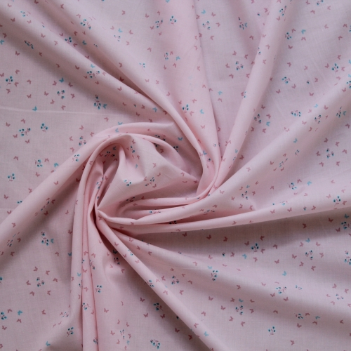 Tissu batiste de coton fond rose imprimé petits papillons