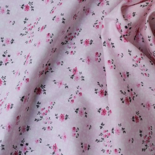 Tissu popeline de coton fond rose imprimé petites fleurs