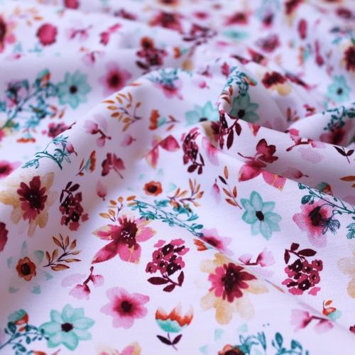 Tissu popeline de coton fond blanc imprimé fleurs