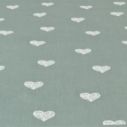 Popeline de coton fond vert eucalyptus imprimé coeurs blanc