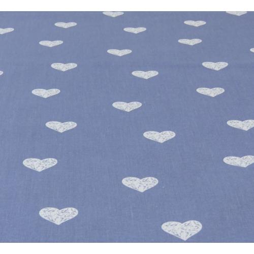 Popeline de coton fond bleu jean imprimé coeurs blanc