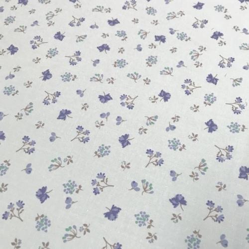 Tissu popeline de coton fond rose clair imprimé fleurs