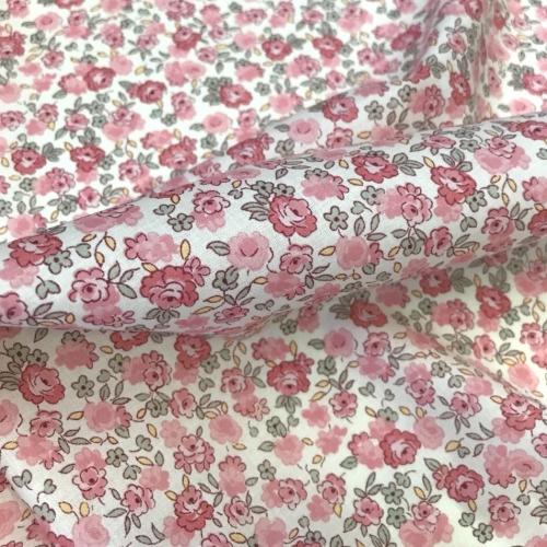 Tissu batiste de coton fond blanc fleurs rose